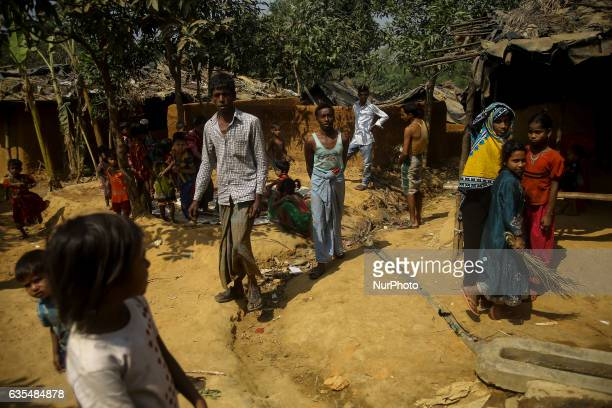 A Rohingya community are seen outside their makeshift refugees camp in Kutupalong Bangladesh on February 15 2017 Almost 60000 thousand refugees from...