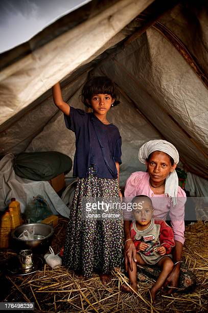 Rohingya family are forced to share a small tent in the IDP refugee camps of Sittwe Sittwe now has over 125000 people who are isolated after violence...