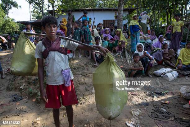 Rohingya gather looking for a place to settle after a new wave of Rohingya arrivals walking across the border from Myanmar September 24 2017 in...