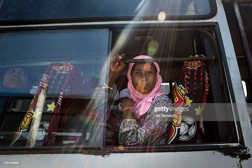 Rohingya girl sits on a bus as relocated to their new temporary shelter on May 13 2015 in Lhoksukon Aceh province Indonesia Boats carrying over 500...