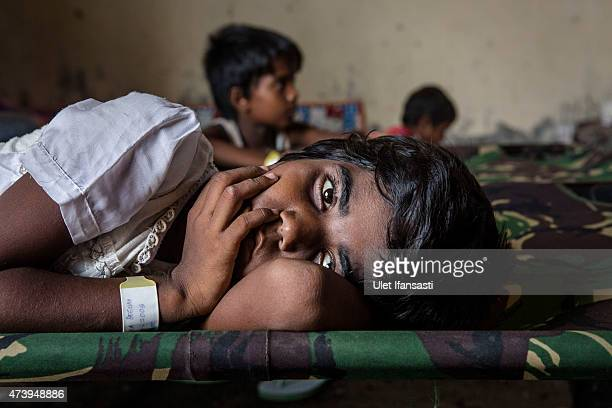 Rohingya girl take a rest at a temporary shelter on May 19 2015 in Kuala Langsa Aceh province Indonesia Hundreds of Myanmar's Rohingya refugees...