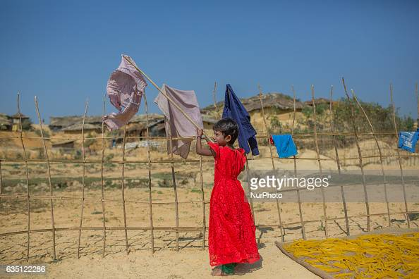 A Rohingya kid dries clothes at Kutupalong Refugee Camp Cox's Bazar Bangladesh on February 13 2017 After attacks by Rohingya militants on border...
