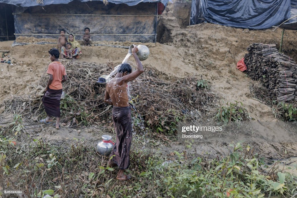 A Rohingya man bathes at a newly set-up refugee camp at Balukhali in Cox's Bazar, Bangladesh, on Tuesday, Sept. 12, 2017. Myanmar's leader Aung San Suu Kyi is under attack over her response to a fresh round of violence that has seen more than 145,000 minority Rohingya Muslims flee into neighboring Bangladesh since last month. Photographer: Ismail Ferdous/Bloomberg via Getty Images