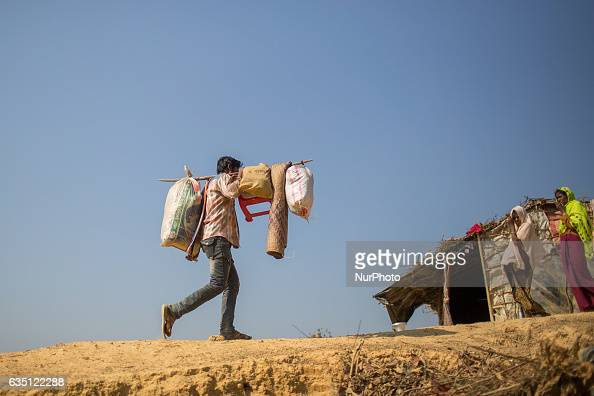 A rohingya man carryies his necessary goods at Kutupalong Refugee Camp Cox's Bazar Bangladesh on February 13 2017 After attacks by Rohingya militants...