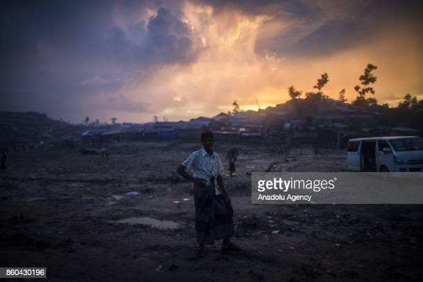 COX'S BAZAR BANGLADESH SEPTEMBER 27 A Rohingya man is seen during a rainy day at the Tankhali makeshift camp in Cox's Bazar Bangladesh on September...