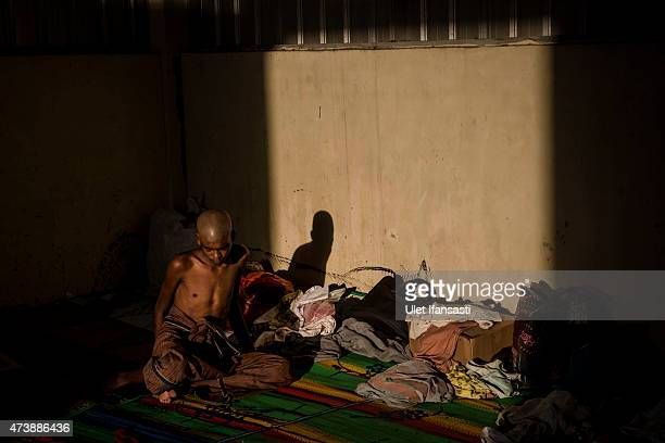 Rohingya migrant sits inside a temporary shelter on May 18 2015 in Kuala Langsa Aceh province Indonesia Hundreds of Myanmar's Rohingya refugees...