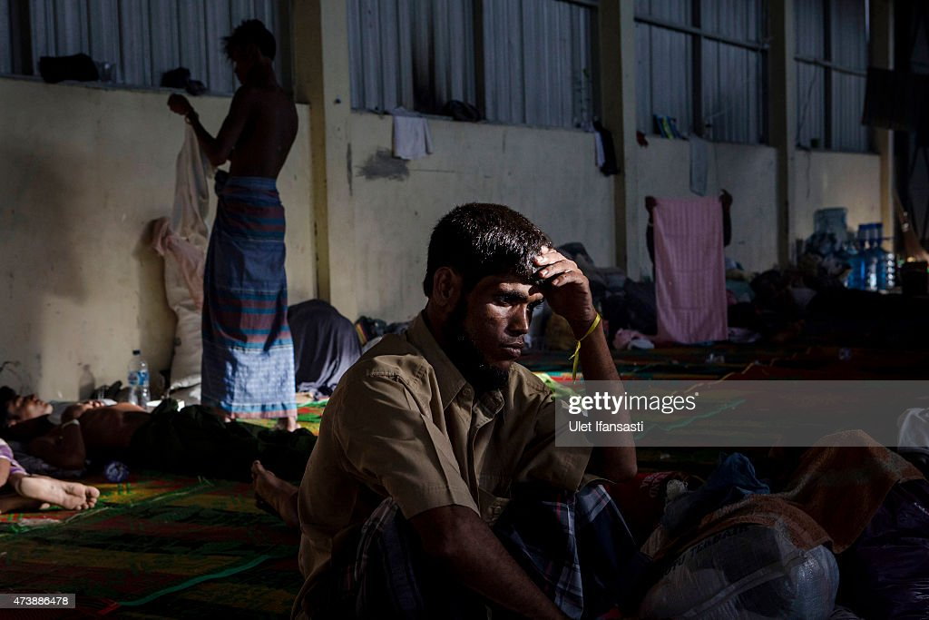A Rohingya migrant sits inside a temporary shelter on May 18, 2015 in Kuala Langsa, Aceh province, Indonesia. Hundreds of Myanmar's Rohingya refugees arrived in Indonesia on May 15, many requiring medical attention. Thousands more are believed to still be stranded at sea reportedly with no country in the region willing to take them in. Myanmar's Rohingya Muslim community have long been persecuted and marginalized by Myanmar's mostly Buddhist population.