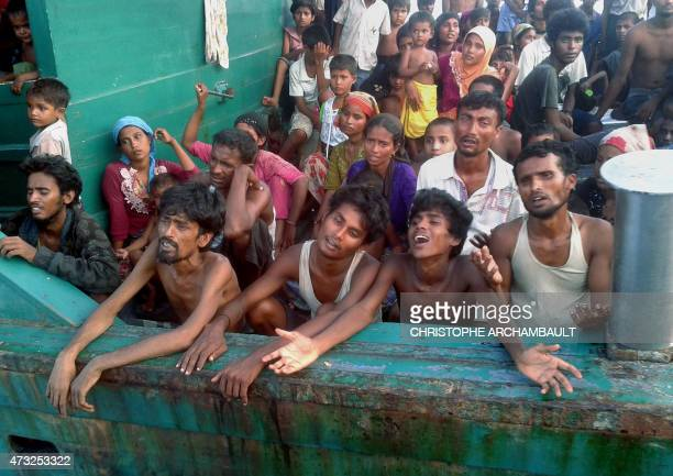 Rohingya migrants are pictured on a boat off the southern Thai island of Koh Lipe in the Andaman Sea on May 14 2015 The boat crammed with scores of...