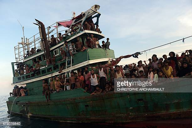 Rohingya migrants sit and stand on a boat drifting in Thai waters off the southern island of Koh Lipe in the Andaman sea on May 14 2015 A boat...
