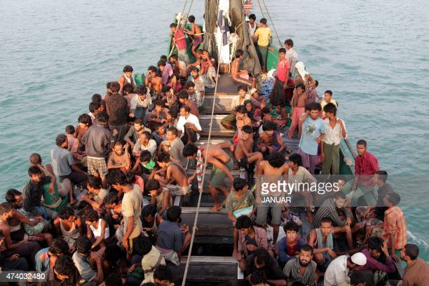 Rohingya migrants sit in a boat off the coast near the city of Geulumpang in Indonesia's East Aceh district of Aceh province before being rescued on...