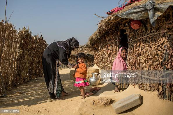 A Rohingya mother takes care of her daughter at Kutupalong Refugee Camp Cox's Bazar Bangladesh on February 13 2017 After attacks by Rohingya...