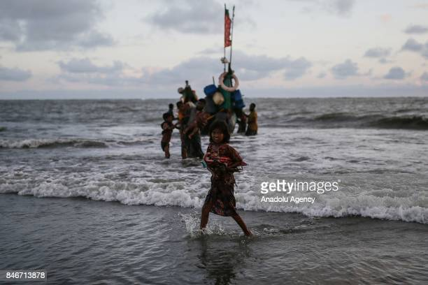 COX'S BAZAR BANGLADESH SEPTEMBER 13 A Rohingya Muslim girl fled from ongoing military operations in Myanmars Rakhine state carries an umbrella as she...