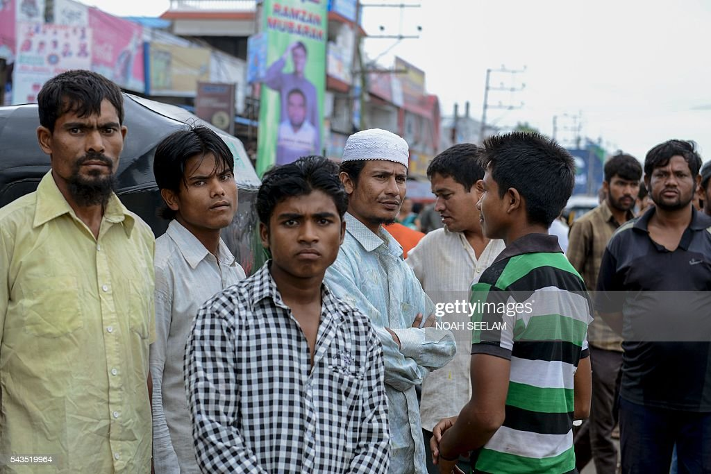 Rohingya Muslim men wait for work as daily labourers at a road junction in the old city of Hyderabad on June 29, 2016. More than 1,200 Rohingya Muslims fleeing sectarian violence in Myanmar have settled in crammed quarters and makeshift shelters in the old city in Hyderabad, in the southern Indian state of Telangana. The Rohingyas have been described by the United Nations as one of the world's most persecuted minorities. They have fled Myanmar in their thousands in recent years as hardline monks and Buddhist nationalists fiercely oppose moves to recognise them as an official minority and insist on calling them 'Bengalis' -- shorthand for illegal migrants from the border with Bangladesh. / AFP / NOAH