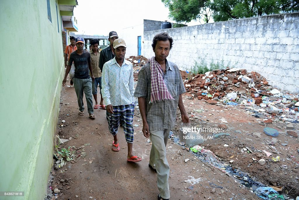 Rohingya Muslim men walk on their to work as daily labourers from their refugee camp in the old city of Hyderabad on June 29, 2016. More than 1,200 Rohingya Muslims fleeing sectarian violence in Myanmar have settled in crammed quarters and makeshift shelters in the old city in Hyderabad, in the southern Indian state of Telangana. The Rohingyas have been described by the United Nations as one of the world's most persecuted minorities. They have fled Myanmar in their thousands in recent years as hardline monks and Buddhist nationalists fiercely oppose moves to recognise them as an official minority and insist on calling them 'Bengalis' -- shorthand for illegal migrants from the border with Bangladesh. / AFP / NOAH