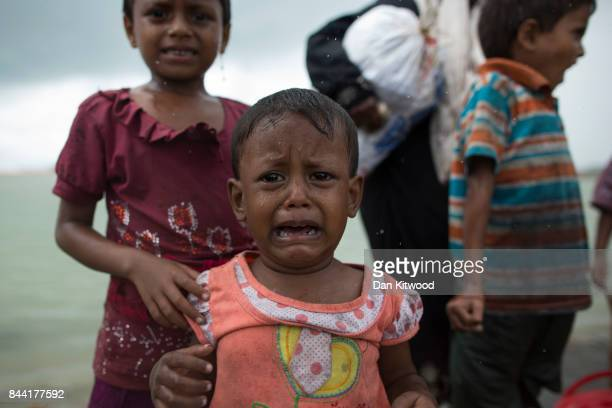 Rohingya Muslim refugee child cries during a rain storm after arriving by boat from Myanmar on September 08 2017 in Dakhinpara Bangladesh Thousands...