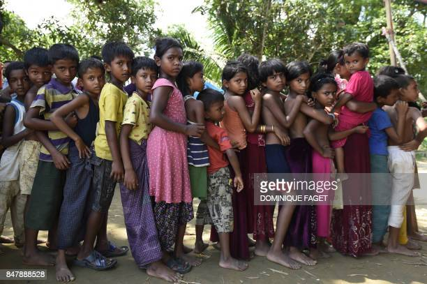 TOPSHOT Rohingya Muslim refugee children wait for medical treatment at the Jalpatoli refugee camp in the 'no mans land' between Myanmar and...