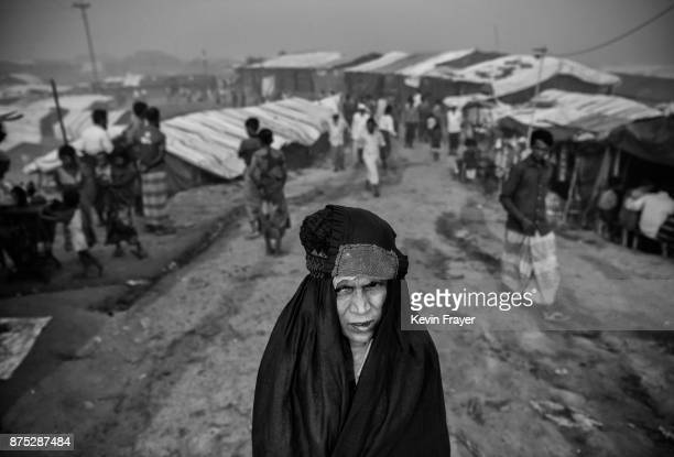 COX'S BAZAR BANGLADESH OCTOBER 27 A Rohingya Muslim refugee woman walks near shelters on October 27 2017 at the Kutupalong refugee camp in Cox's...