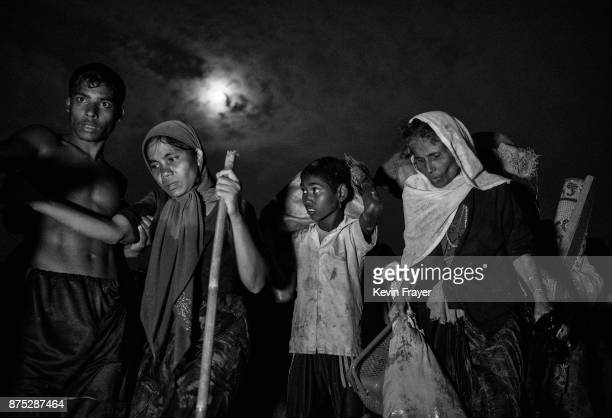 COX'S BAZAR BANGLADESH NOVEMBER 01 Rohingya Muslim refugees carry their belongings after fleeing over the border from Myanmar into Bangladesh at the...
