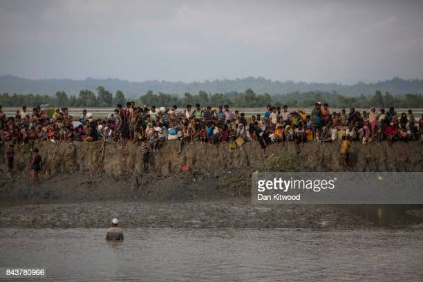 Rohingya Muslim refugees gather on a mud bank after security forces temporarily stopped people crossing into Bangladesh on September 07 2017 in...