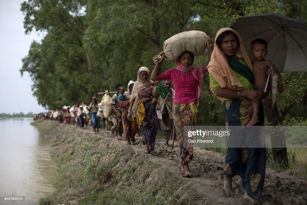 Rohingya Muslim refugees make their way into Bangladesh after crossing the Myanmar Bangladesh border on September 07, 2017 in Whaikhyang Bangladesh. Thousands of Rohingya continue to cross the border after violence erupted in Myanmar's Rakhine state when the country's security forces allegedly launched an operation against the Rohingya Muslim community.