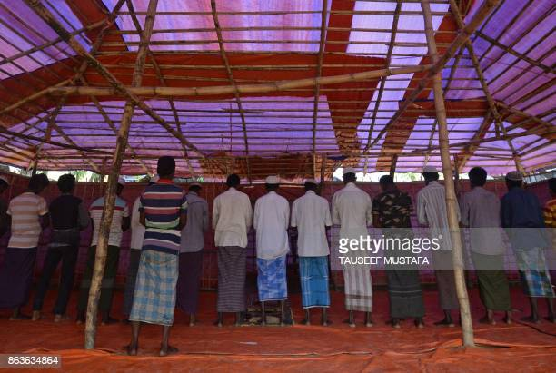 TOPSHOT Rohingya Muslim refugees offer prayers at Thaingkhali refugee camp in Ukhia on October 20 2017 Some 582000 Rohingya refugees have fled their...