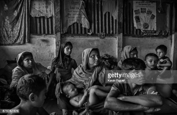 COX'S BAZAR BANGLADESH OCTOBER 24 Rohingya Muslim refugees rest inside a local school being used as a temporary shelter for new arrivals on October...