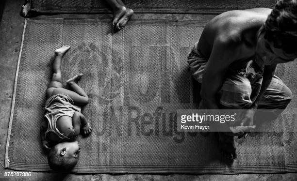 COX'S BAZAR BANGLADESH OCTOBER 27 Rohingya Muslim refugees rest inside a local school being used as a temporary shelter for new arrivals on October...