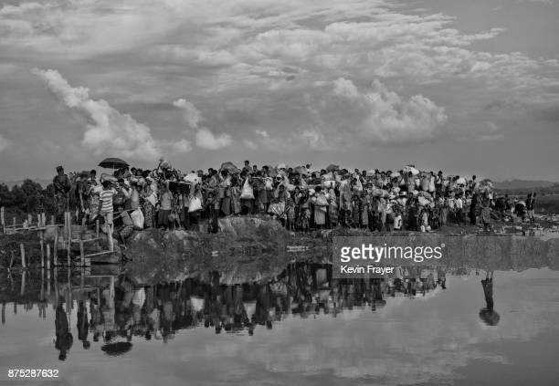 COX'S BAZAR BANGLADESH NOVEMBER 02 Rohingya Muslim refugees waiting to proceed to camps after crossing the border from Myanmar into Bangladesh crowd...