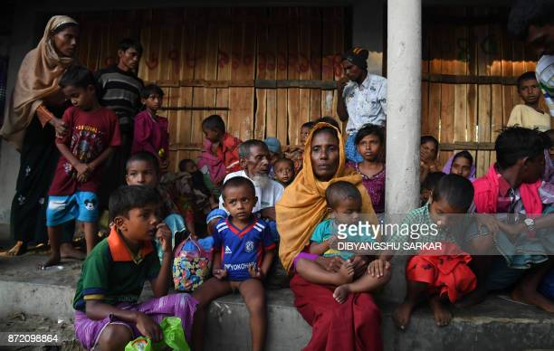 Rohingya Muslim refugees who entered Bangladesh by boat rest as they wait to go to refugee camps after landing at the Saplapur beach in the Teknaf...