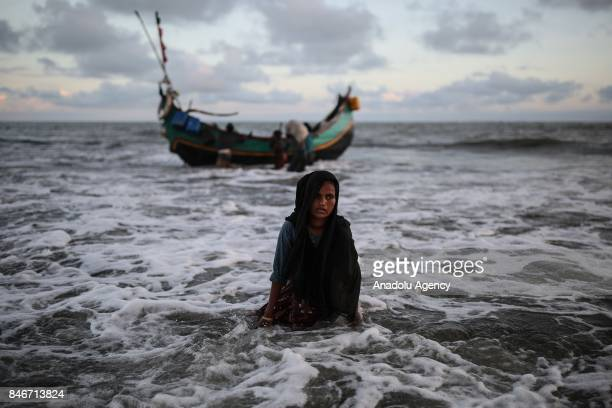 COX'S BAZAR BANGLADESH SEPTEMBER 13 A Rohingya Muslim woman fled from ongoing military operations in Myanmars Rakhine state gets off a boat while...
