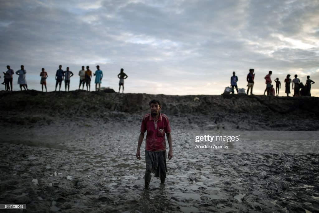 COX'S BAZAR, BANGLADESH - SEPTEMBER 8: Rohingya Muslims, fled from ongoing military operations in Myanmars Rakhine state, make their way to enter Bangladesh at Naf River, the border of Bangladesh and Myanmar, in Cox's Bazar, Bangladesh on September 8, 2017. Violence erupted in Myanmars Rakhine state on Aug. 25 when the countrys security forces launched an operation against the Rohingya Muslim community. It triggered a fresh influx of refugees towards neighboring Bangladesh, though the country sealed off its border to refugees.