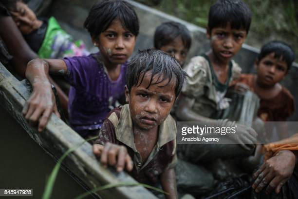 COX'S BAZAR BANGLADESH SEPTEMBER 12 Rohingya Muslims fled from ongoing military operations in Myanmars Rakhine state cross the Naf River in Cox's...