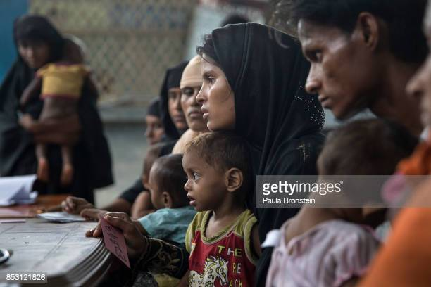 Rohingya parents wait with their children to be registered at the Action Against Hunger in the Out Patient Therapeutic program on September 24 2017...