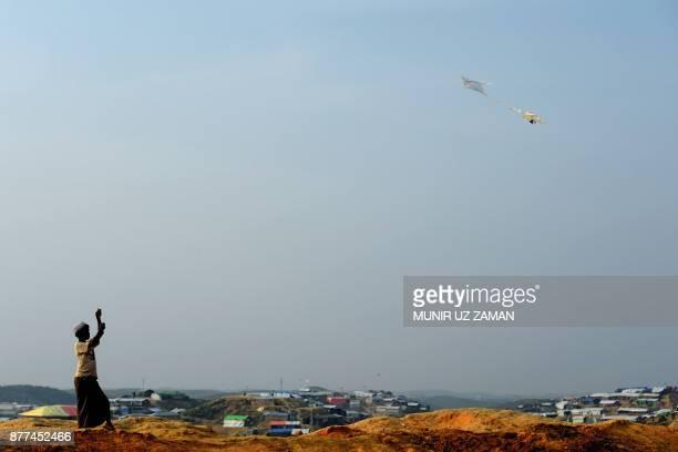 Rohingya refugee boy flies a kite at Balukhali refugee camp in the Bangladeshi district of Ukhia on November 22 2017 An estimated 618000 Muslim...