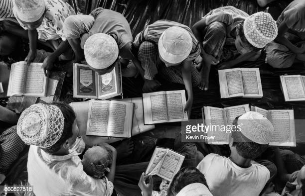 COX'S BAZAR BANGLADESH OCTOBER 03 Rohingya refugee boys study the Quran Islam's holy book at a madrassa or religious school on October 2 2017 in...