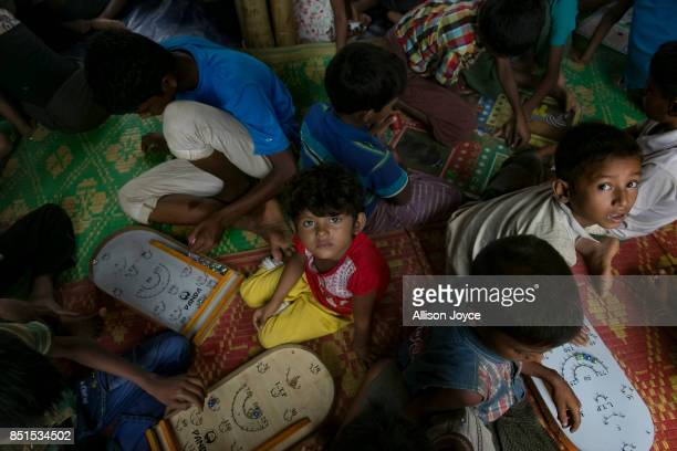 COX'S BAZAR BANGLADESH SEPTEMBER 19 Rohingya refugee children are seen at a CODEC and UNICEF 'child friendly space' on September 19 2017 in Cox's...