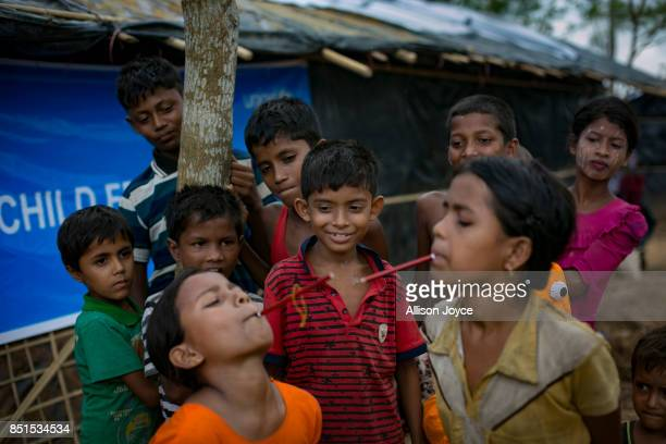 COX'S BAZAR BANGLADESH SEPTEMBER 21 Rohingya refugee children play a game at a CODEC and UNICEF 'child friendly space' on September 21 2017 in Cox's...