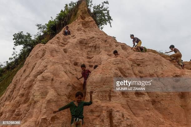 TOPSHOT Rohingya refugee children play at Thankhali refugee camp in the Bangladeshi district of Ukhia on November 17 2017 An estimated 618000 Muslim...