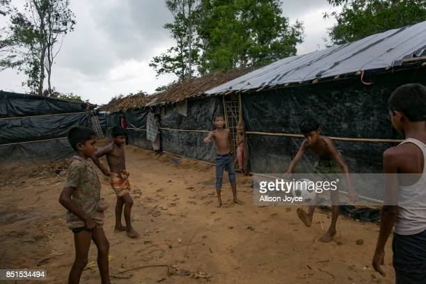 COX'S BAZAR BANGLADESH SEPTEMBER 21 Rohingya refugee children play football at a CODEC and UNICEF 'child friendly space' on September 21 2017 in...