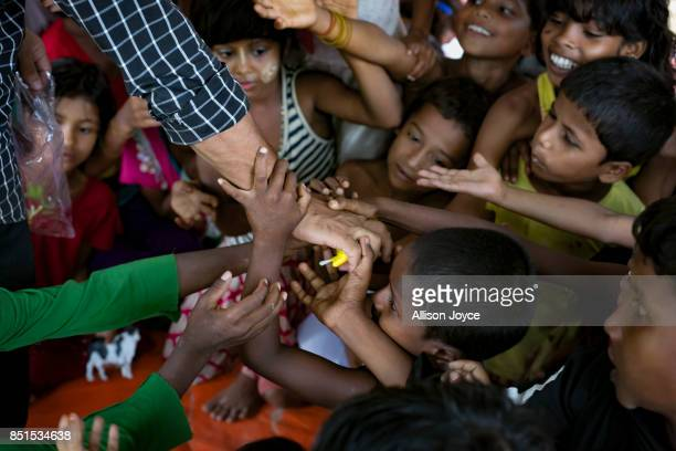 COX'S BAZAR BANGLADESH SEPTEMBER 19 Rohingya refugee children reach for a toy at a CODEC and UNICEF 'child friendly space' on September 19 2017 in...