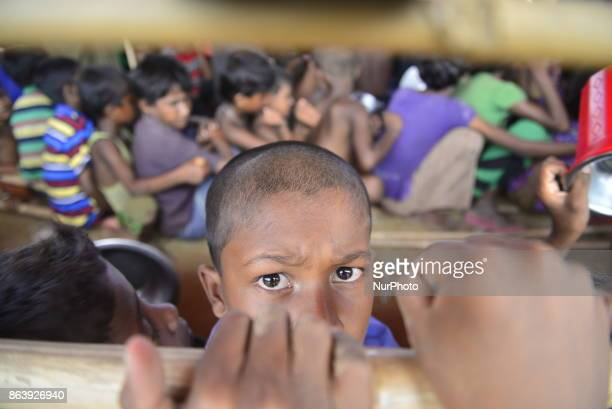 Rohingya refugee children wait to collect food at the palongkhali makeshift Camp in Cox's Bazar Bangladesh on September 06 2017 According to the...
