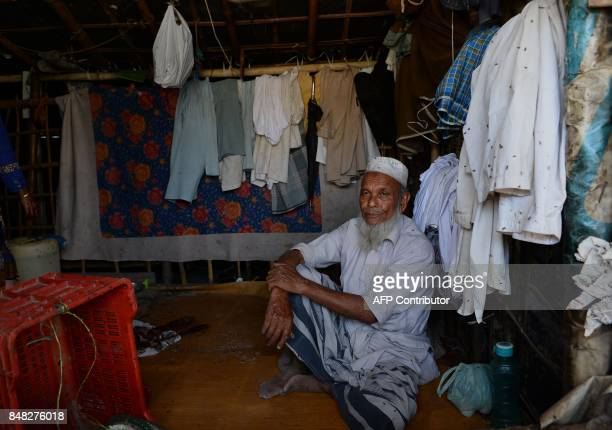 A Rohingya refugee man sits inside his shelter in New Delhi on September 17 2017 Detested in Myanmar the Muslim Rohingya desperately seeking a...