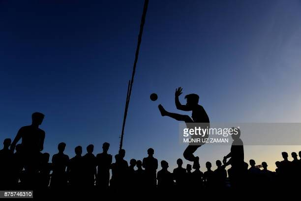 TOPSHOT Rohingya refugee men play with a ball at Jamtoli refugee camp in the Bangladeshi district of Ukhia on November 18 2017 An estimated 618000...
