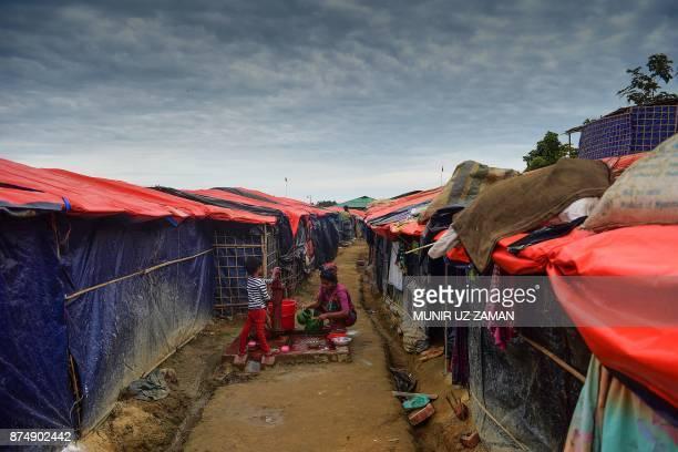 Rohingya refugee woamn washes cloths at Thankhali refugee camp in the Bangladeshi district of Ukhia on November 16 2017 More than 600000 Rohingya...