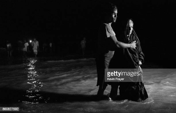 COX'S BAZAR BANGLADESH SEPTEMBER 27 A Rohingya refugee woman is helped from a boat after arriving on the Bangladesh side of the Naf River at night...