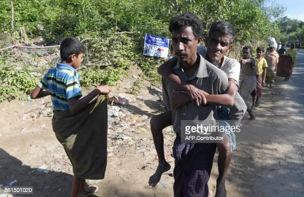 Rohingya refugees arrive at Balukhali refugee camp in the Bangladeshi district of Ukhia on October 15 2017 Bangladesh's home minister said on October...