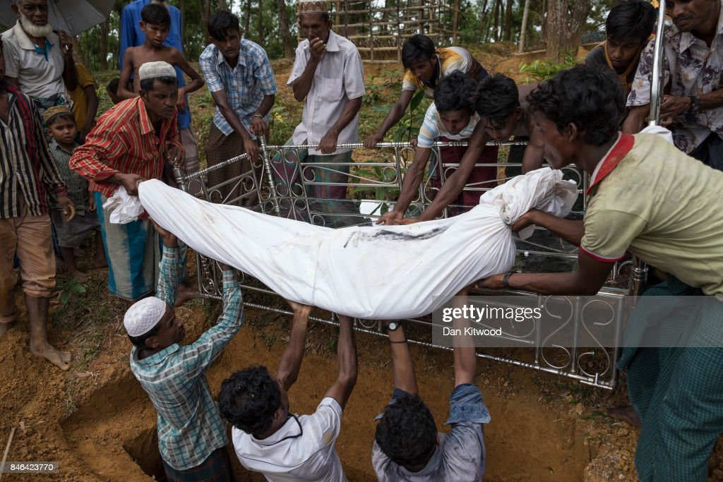 Rohingya refugees bury Nur Ali, 50 who died of gunshot wounds he sustained while fleeing violence in Myanmar, on September 13, 2017 in Kutupalong, Bangladesh. Recent reports have suggested that nearly 400,000 Rohingya have now fled Myanmar after violence erupted in Rakhine state. Myanmar's leader Aung San Suu Kyi has reportedly cancelled her plans to attend the UN General Assembly after strong international criticism for not speaking out about the violence against the Rohingya Muslim population.