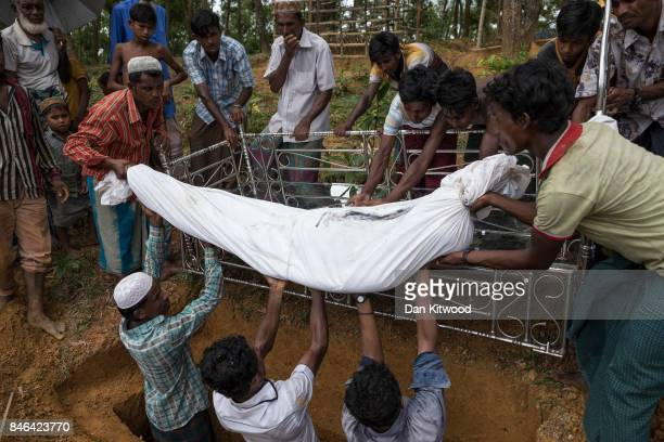 Rohingya refugees bury Nur Ali 50 who died of gunshot wounds he sustained while fleeing violence in Myanmar on September 13 2017 in Kutupalong...