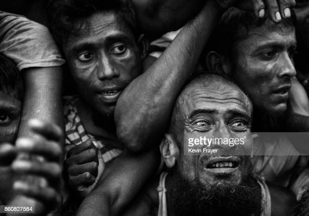 COX'S BAZAR BANGLADESH SEPTEMBER 20 Rohingya refugees desperate for aid crowd as food is distributed by a local NGO near the Balukali refugee camp on...