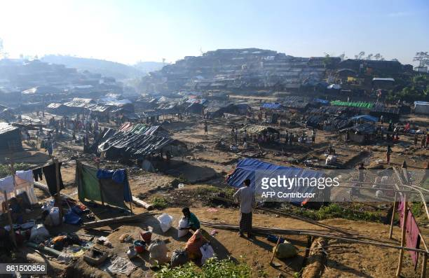 Rohingya refugees dismantle a roadside camp before moving to Ghumdhum camp as ordered by the Bangladeshi administration at the Thaingkhali refugee...